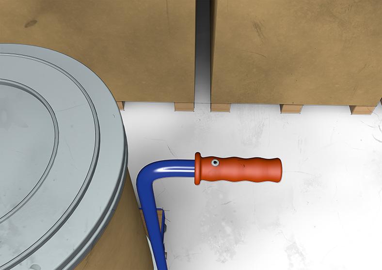 Detailbild mit dem festvernieteten roten Kunststoffgriff eines Handwagens.