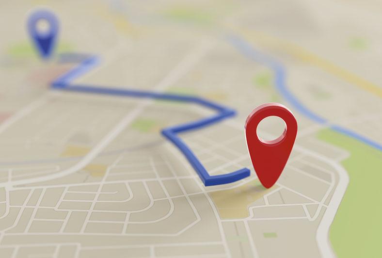 Das Bild zeigt die dreidimensionale Grafik einer Landkarte mit einem stehenden roten Ortskennzeichen.